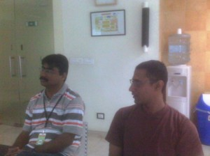 Venkat and Rafi listeing to Venkatesh (not in the picture) explaining the 'why' behing daily Scrum meetings